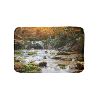 The beautiful waterfall in forest, autumn bath mats
