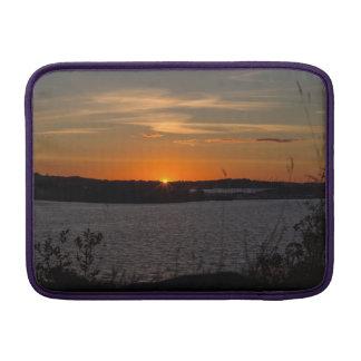 The buzzer sunset MacBook sleeve