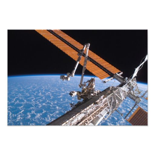 The Canadarm2 and solar array panel wings Photograph