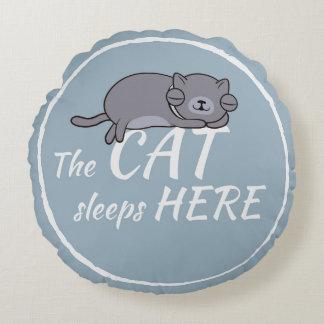 The cat sleeps here round cushion