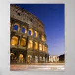 the Colosseum ampitheatre illuminated at night Poster