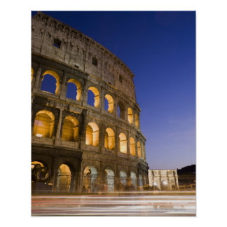 the Colosseum ampitheatre illuminated at night Poster
