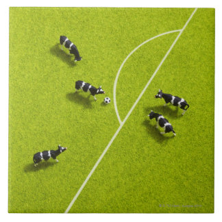 The cows playing soccer large square tile
