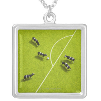 The cows playing soccer silver plated necklace