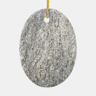 The flat surface of a gray granite stone christmas ornament