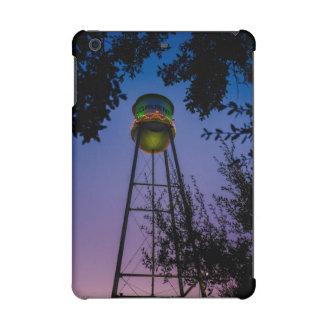 The Gruene water tower with the purple evening sky
