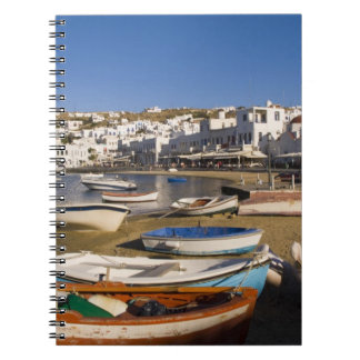 The harbor town with colorful fishing boats notebooks