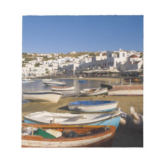 The harbor town with colorful fishing boats notepad