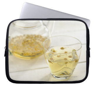 The herb tea which a glass teapot and a cup laptop sleeve