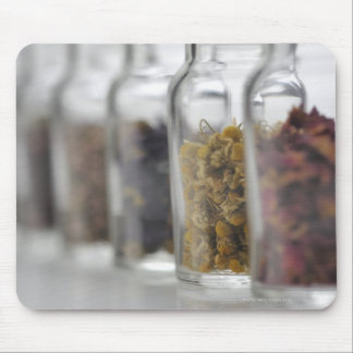The herbs which a glass bottle contains mouse mat