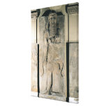 The hero Gilgamesh holding a lion Canvas Prints