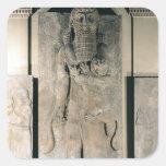 The hero Gilgamesh holding a lion Square Sticker