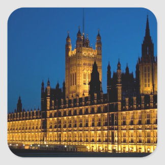 The Houses of Parliament at night in the city of Square Sticker