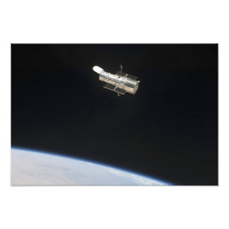 The Hubble Space Telescope in orbit above Earth 2 Photo