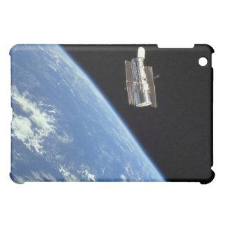 The Hubble Space Telescope with a blue earth iPad Mini Cases
