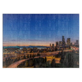 The I-5 freeway and downtown Seattle at twilight Cutting Board