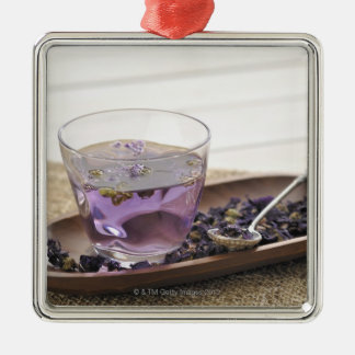 The mallow herb tea which a glass cup contains, christmas ornament