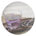 The mallow herb tea which a glass cup contains, dinner plates