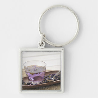 The mallow herb tea which a glass cup contains, key ring