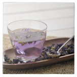 The mallow herb tea which a glass cup contains, large square tile
