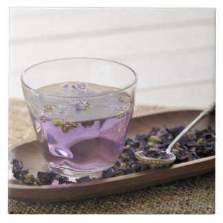 The mallow herb tea which a glass cup contains, tile