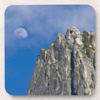 The moon rises and shines through the clouds beverage coasters