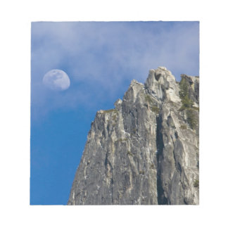 The moon rises and shines through the clouds note pad