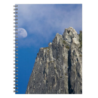 The moon rises and shines through the clouds notebooks