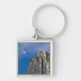 The moon rises and shines through the clouds Silver-Colored square key ring