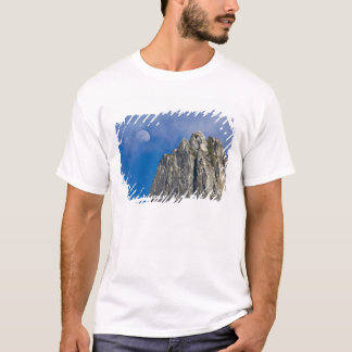 The moon rises and shines through the clouds T-Shirt