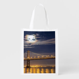 The moonrise tonight over the Bay Bridge Reusable Grocery Bag