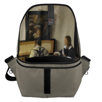 The Music Lesson by Johannes Vermeer Courier Bag