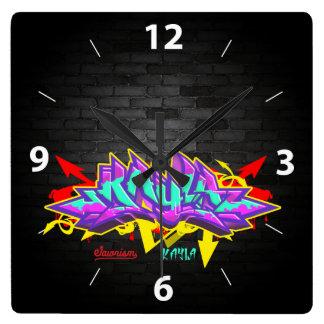 The name Kayla in graffiti Square Wall Clock