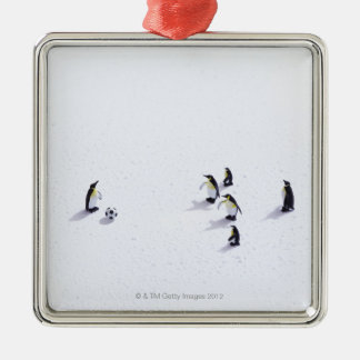 The penguins playing soccer Silver-Colored square decoration