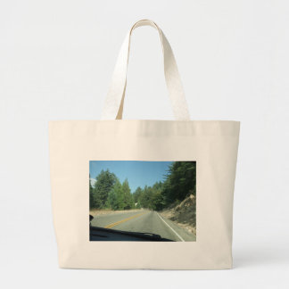 The Road Goes On Canvas Bags