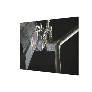 The robotic arm of the Japanese Experiment Modu Canvas Print