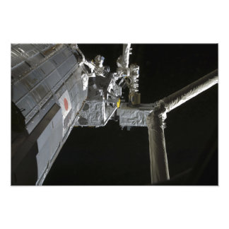 The robotic arm of the Japanese Experiment Modu Photo Print