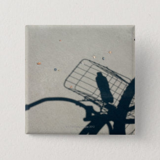 The shadow of a bicycle with a bottle of water 15 cm square badge