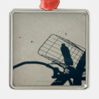 The shadow of a bicycle with a bottle of water Silver-Colored square decoration