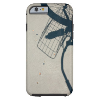 The shadow of a bicycle with a bottle of water tough iPhone 6 case