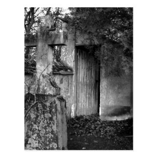 The shed in the cemetery in black and white postcard