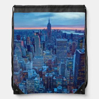 The skyscrapers of Manhattan are lit Rucksacks