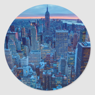 The skyscrapers of Manhattan are lit Classic Round Sticker