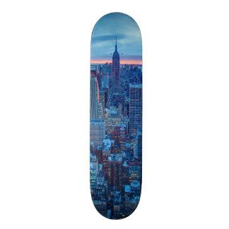 The skyscrapers of Manhattan are lit Custom Skate Board