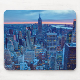 The skyscrapers of Manhattan are lit Mouse Mat
