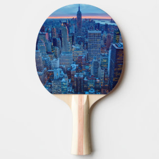 The skyscrapers of Manhattan are lit Ping Pong Paddle