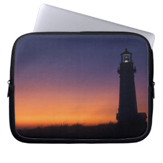 The sun ball drops down on the colorful horizon laptop sleeve