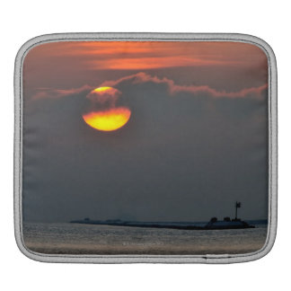 The sun emerges through an off-shore fog bank iPad sleeve