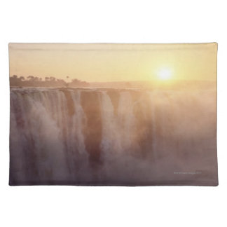 The sun rises behind the spray from Victoria Placemats