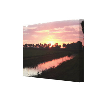 The Sun Rises Over The Land Canvas Print